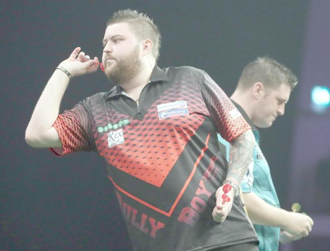 Michael Smith continued a winning start to the Premier League season when he defeated Daryl Gurney in Cardiff on Thursday. Picture: Lawrence Lustig/PDC