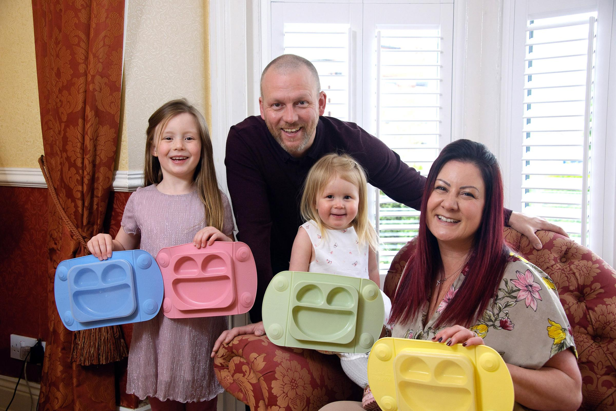 Helen Davies with her partner Lloyd and their two children Elora, six, and Keira, three