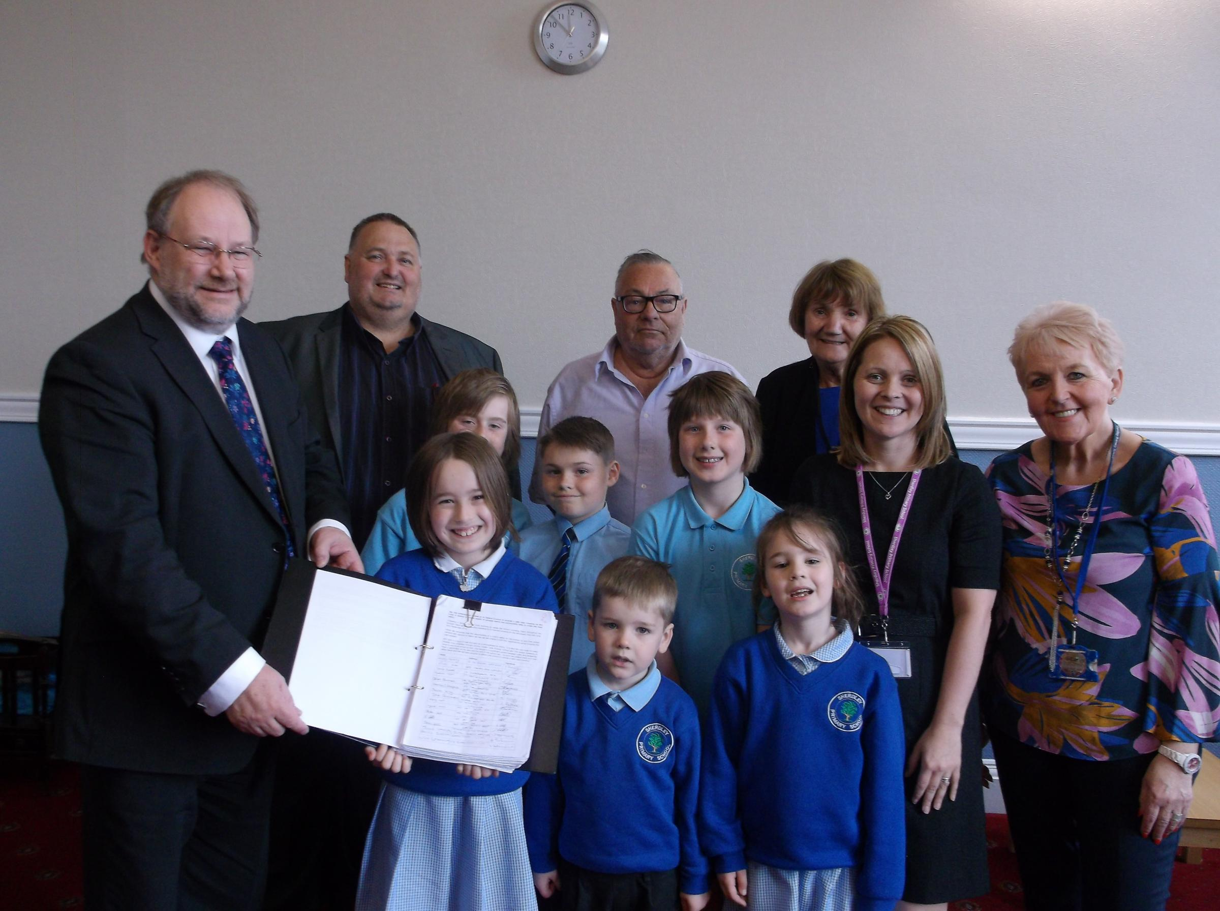 Governor Kirsty Farrelly (second right) with Ann-Marie Lakey (children & families support co-ordinator), ward councillors, leader Derek Long (left) and some of the junior road safety officers and school council representatives
