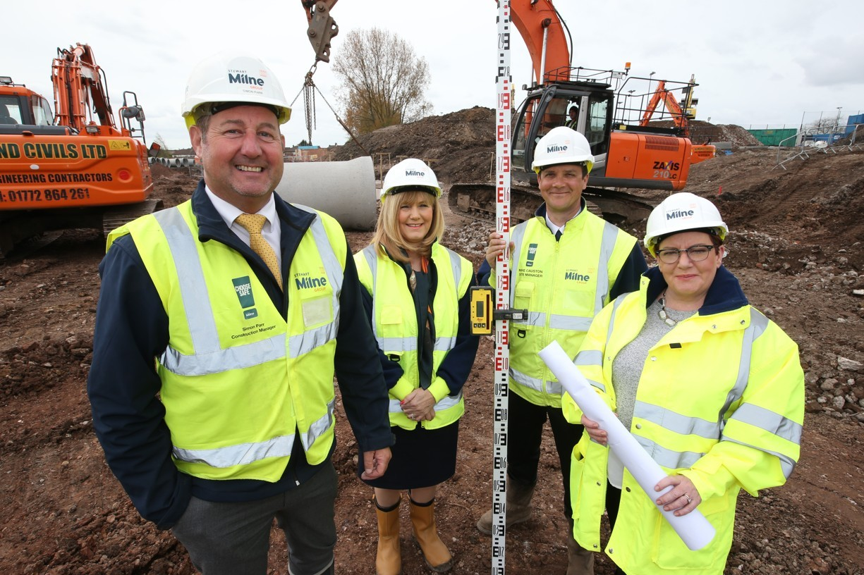 Simon Parr, Construction Manager, Angela Halliwell, Sales Consultant, Mike Causton, Site Manager and Lynne Vogel, Sales Manager all Stewart Milne Homes at the development.