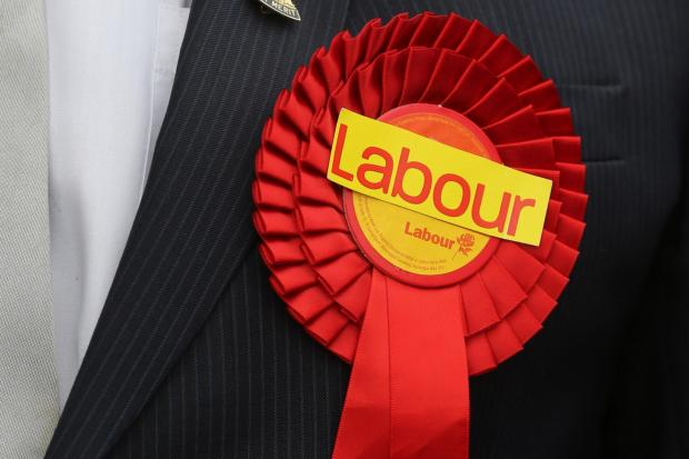 Labour held both seats in St Helens but suffered heavy losses elsewhere