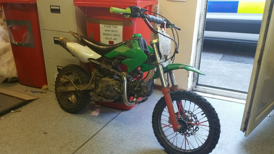 The green bike was seized by officers Pic: Knowsley Police