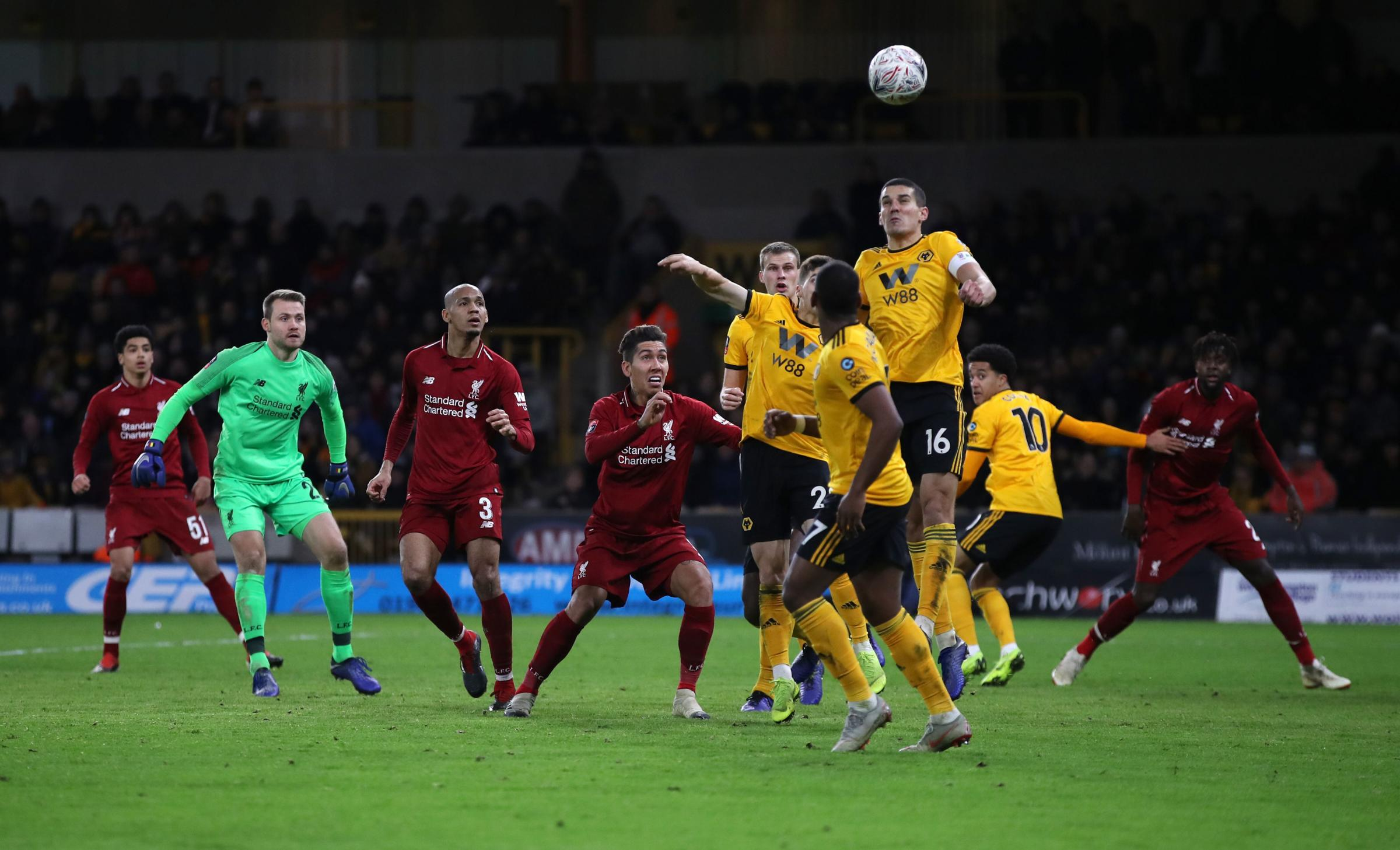 Liverpool goalkeeper Simon Mignolet (second left) comes up for a Liverpool corner in the final minutes during the Emirates FA Cup, third round match at Molineux, Wolverhampton. Conor Coady is number 16.Pic: Nick Potts PA Wire