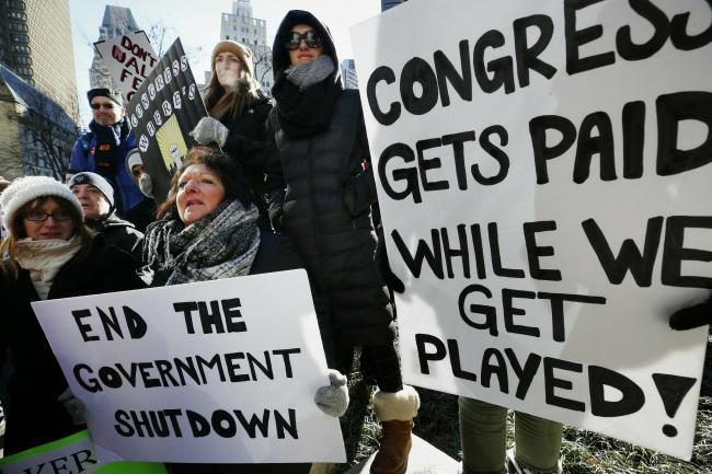 Government workers and supporters during a protest over the shutdown