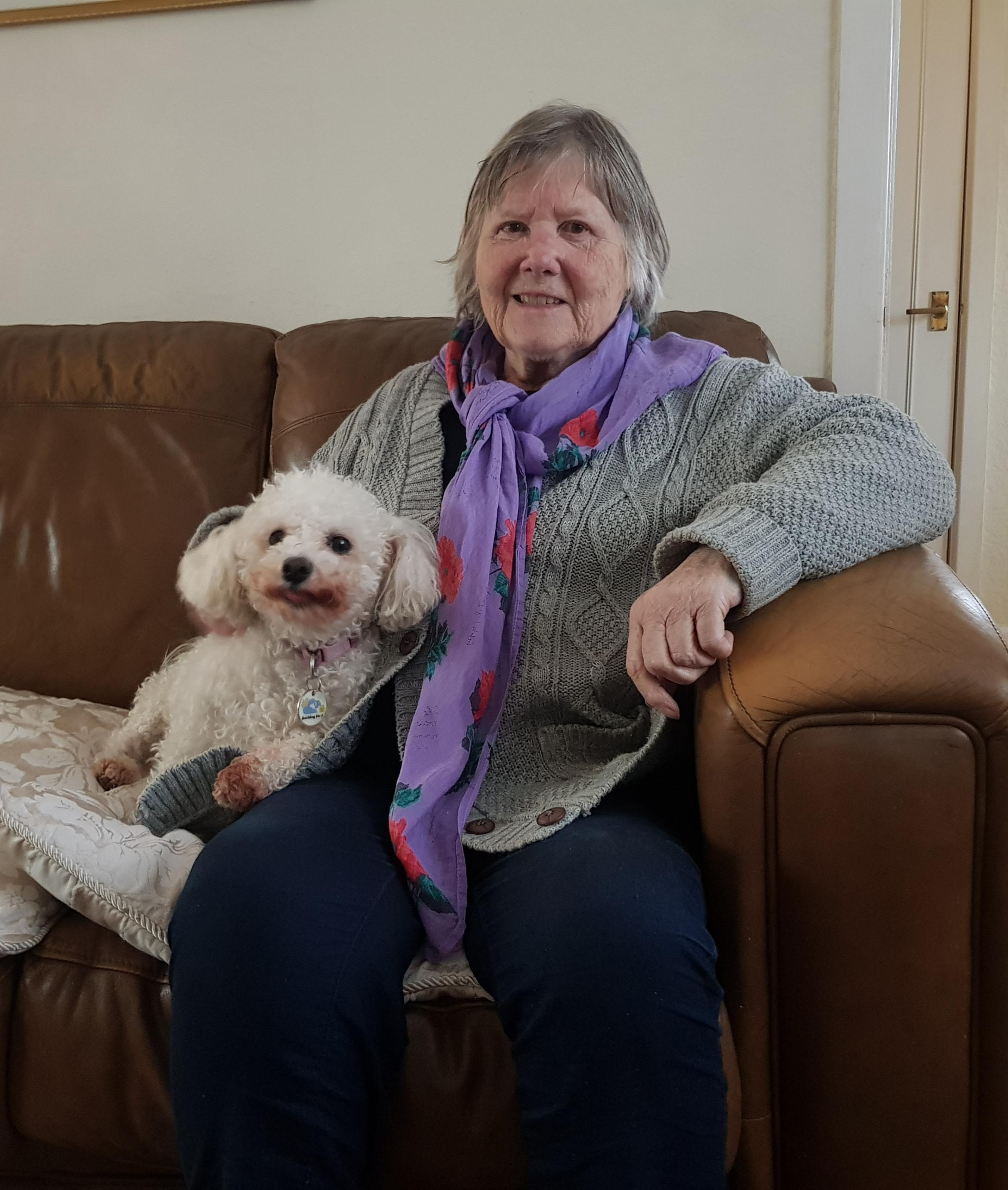 Retiree Beryl with holidaying dog, Belle