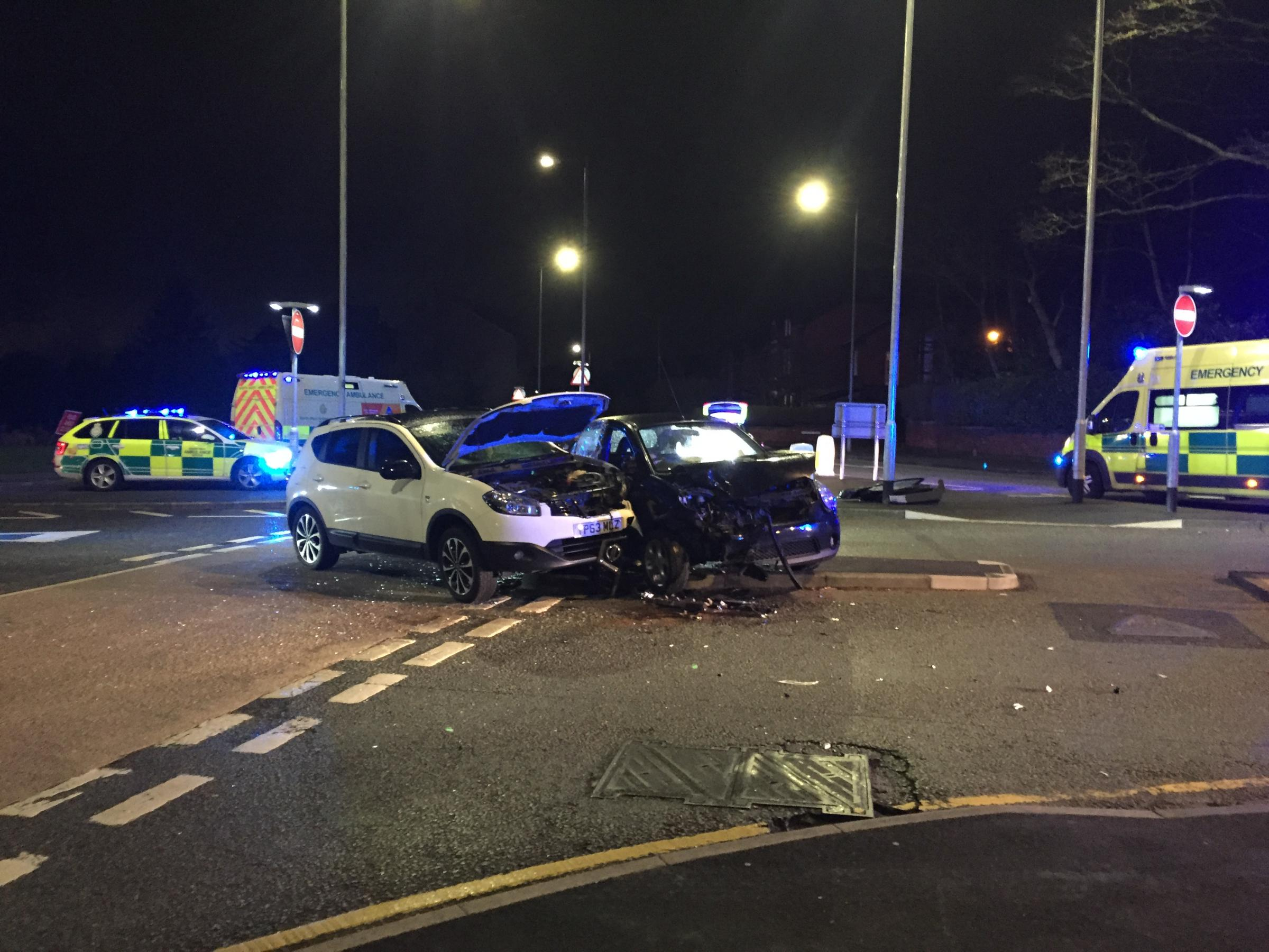 Busy junction closed after two-car crash