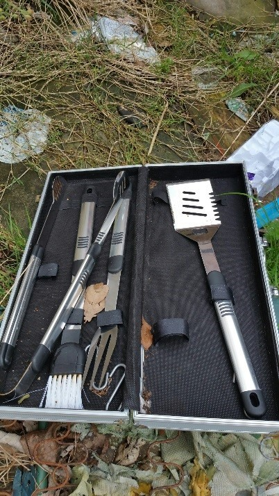 Barbecue tools recovered by police in open land search in Whiston