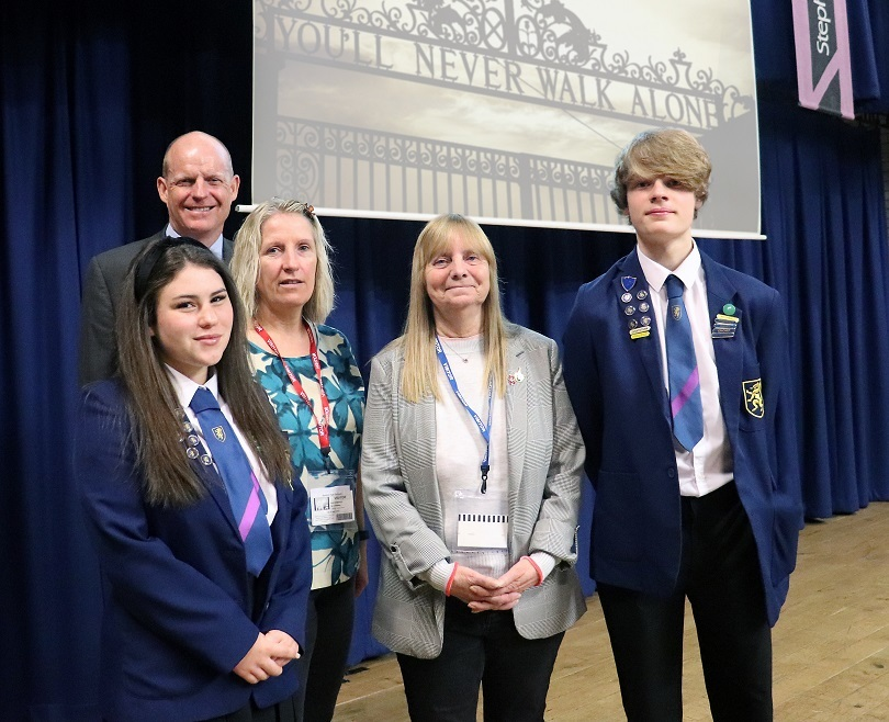 Margaret Aspinall (centre), Sue Roberts and John Pout, flanked by head girl Livvy Sergision and head boy Ethan Watts
