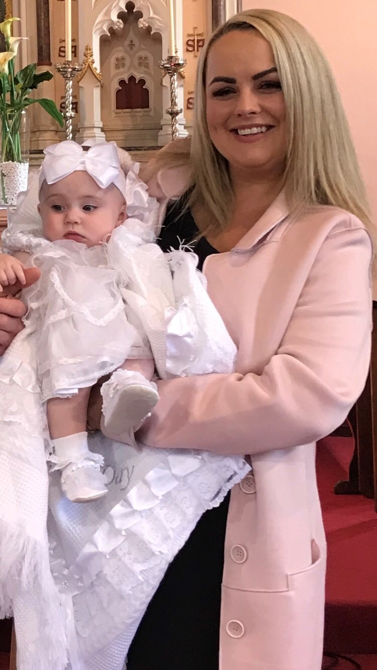 Danielle with her daughter Darcie the next day at her christening, a day both could have missed due to the incident