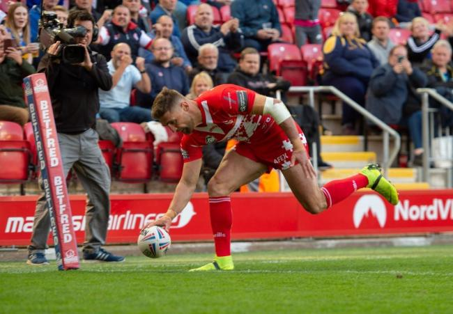 Tommy Makinson touching down for St Helens against Castleford Tigers at Anfield during Magic Weekend 2019. Picture: Bernard Platt